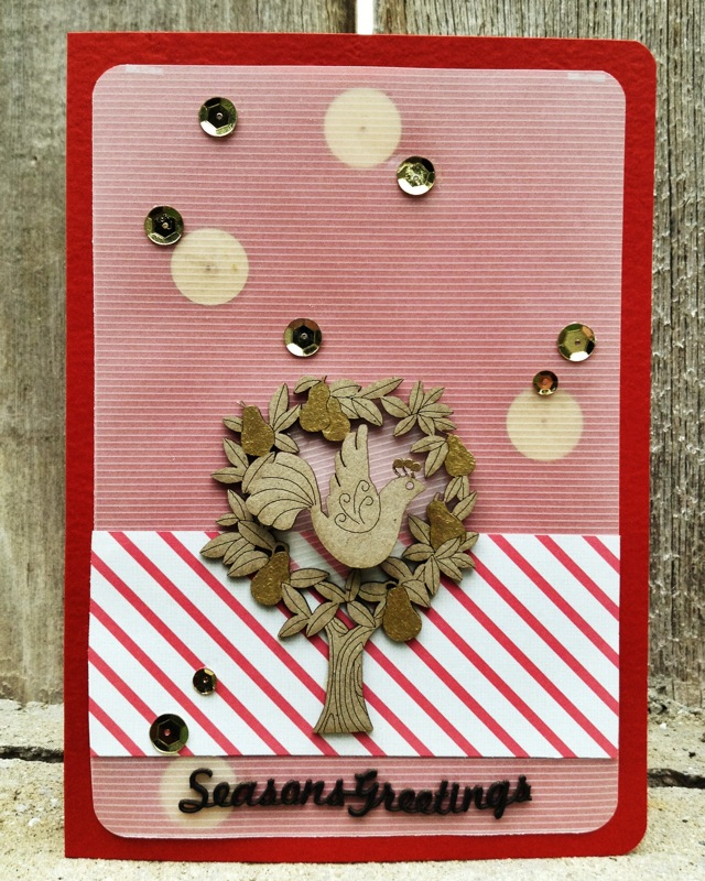 I used vellum and red card stock as a base. I LOVE the Partridge In A Pear Tree design!